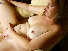 Steamy American mom playing with her shaved pussy